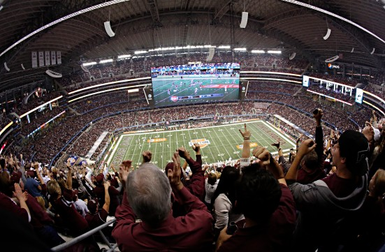 The first National Championship under the new four-team playoff format will be hosted in Dallas, TX.